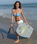 Brooke Burke - wearing a bikini top at a Malibu beach 08/14/12